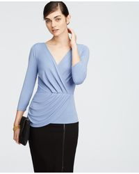 Ann Taylor | Blue Petite Crepe 3/4 Sleeve Wrap Top | Lyst