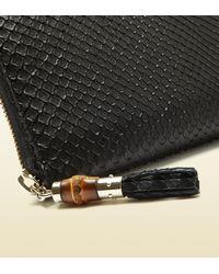 59474a936a7552 Gucci Python Tassel Zip Around Wallet in Black - Lyst