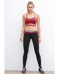 Forever 21 | Red Low Impact - Caged-hem Seamless Sports Bra | Lyst