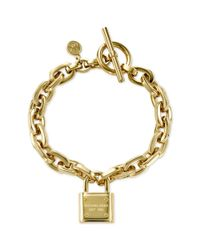 Michael Kors | Metallic Goldtone Chain and Logo Padlock Bracelet | Lyst