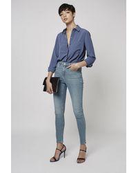 TOPSHOP - Blue Moto Bleach Wash Cain Jeans - Lyst