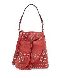 049f22fb77 Lyst - Prada Studded Calfskin Bucket Bag in Red