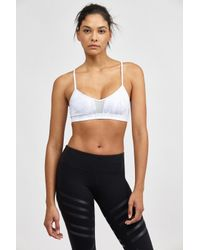 d0134d255de86 Lyst - Alo Yoga Goddess Bra in White