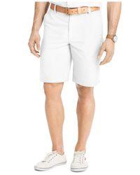 "Izod - Blue Solid Flat-front 7"" Shorts for Men - Lyst"