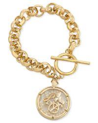 Carolee - Metallic Gold-Tone Shaky Peace Charm Bracelet - Lyst