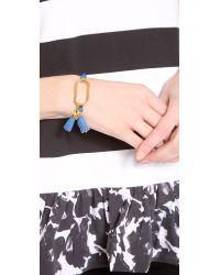 Tory Burch - Blue Tassel Charm Tension Bracelet - Lyst