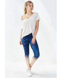 Onzie | Blue Graphic Legging | Lyst