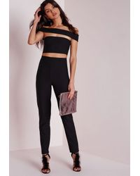 Missguided - Bandage Bardot Tapered Leg Romper Black - Lyst