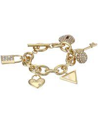 Guess - Metallic Lock, Key, Hearts Charm Bracelet - Lyst