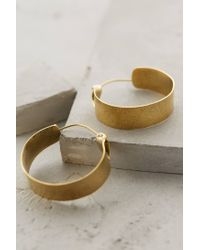 Lena Bernard | Metallic Broad Brass Hoops | Lyst