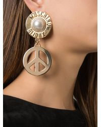 Moschino | Metallic Peace Sign Drop Earrings | Lyst