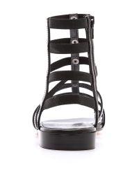 Stuart Weitzman - Black Ceasar Flat Gladiator Sandals - Lyst