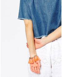 Monki | Orange Billie Chain And Tassel Bracelet | Lyst
