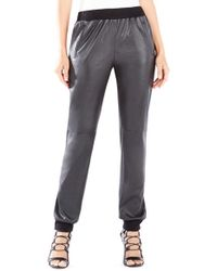 12e42529dac1b0 Lyst - BCBGMAXAZRIA Relaxed-Fit Faux-Leather Pants in Black