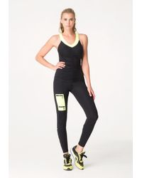Bebe - Yellow Tiger Slash Leggings - Lyst