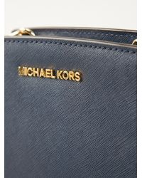 2551eb4b20b6 ... usa michael michael kors mini selma crossbody bag in blue lyst 6208b  92207