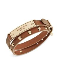 Michael Kors - Metallic Goldtone Stud and Plaque Luggage Leather Wrap Bracelet - Lyst