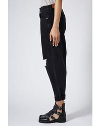 TOPSHOP - Black Ripped Baggy Jeans By Boutique - Lyst