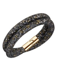 Swarovski | Metallic Gold-tone Black Stardust Wrap Bracelet | Lyst