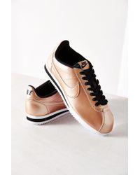 Lyst - Nike Women s Classic Cortez Leather Sneaker in Metallic 98b76b8478