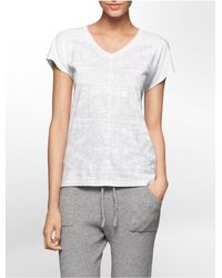 Calvin Klein - White Jeans Glitter Bamboo Print High Low T-shirt - Lyst