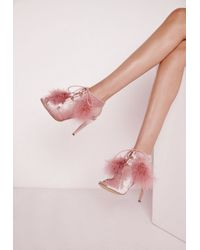 f4d77e03dd9d Lyst - Missguided Pom Pom Lace Up Heeled Sandals Pink in Natural