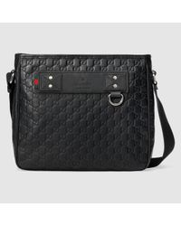dcc7c990a95b Gucci Rubber Ssima Messenger in Black for Men - Lyst