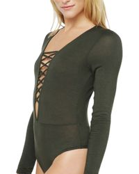 AKIRA | Green Stationed Lace Front Top | Lyst