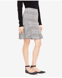 Ann Taylor - Black Petite Glen Plaid Flounce Skirt - Lyst