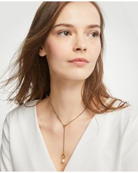 Ann Taylor - Metallic Pearlized Lariat Necklace - Lyst