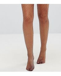 938117ffac5 Lyst - Monki Exclusive Fishnet Tights in Red