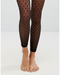 6bfb0e23657 ASOS Mesh Dot Footless Tights in Black - Lyst