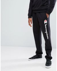 90e18afd50c0 Lyst - Champion Logo Joggers in Black for Men