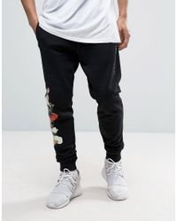 Criminal Damage | Skinny Joggers In Black With Floral Print for Men | Lyst