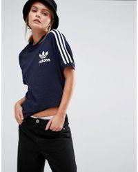 3f5e5e0c adidas Originals. Women's Blue Originals Adicolour Boyfriend T-shirt With 3  Stripe ...
