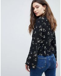 New Look - Black Flared Sleeve Floral Print Blouse - Lyst