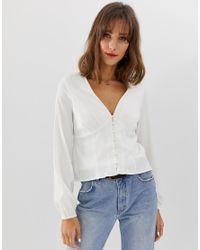 fa226ad21940d4 Vero Moda Volume Sleeve Button Through Tea Blouse in White - Lyst
