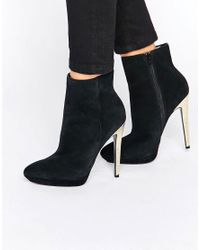 Faith | Black Solo Felix Gold Heeled Ankle Boots | Lyst