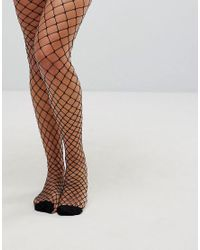 81713c4dae7b7 Vero Moda Fishnet Tights in Black - Lyst