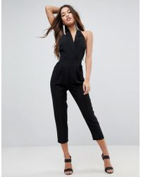 a8429addb60 Lyst - ASOS Tailored Halter Jumpsuit With Lapel Detail And Peg Leg ...