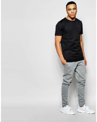 PUMA - Black Evolution T-shirt for Men - Lyst