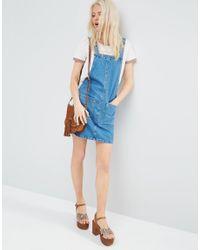 ASOS - Denim Mini Pinafore Dress In Mid-wash Blue - Lyst