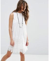 c5aa68a509d0 ASOS Premium Ladder And Lace Swing Dress With High Neck in White - Lyst