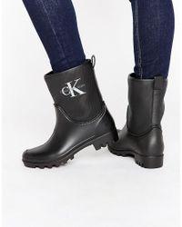 Calvin Klein - Black Jeans Philippa Ankle Wellington Boots - Lyst