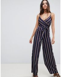 Girl In Mind - Blue Wrap Front Striped Jumpsuit - Lyst