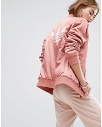 2817b89d512b adidas Originals. Women s Originals Logo Back Bomber Jacket In Dusky Pink