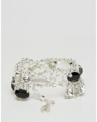 Krystal - Metallic Swarovski Statement Cross Over Bracelet - Lyst