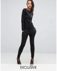 PUMA - Black Exclusive To Asos Lounge Slouchy Jumpsuit - Lyst