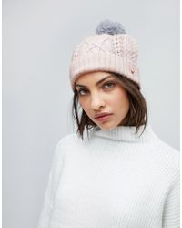 Lyst - Ted Baker Cable Knit Bobble Hat in Pink 29ed3e88691d