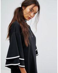 Monki - Black Ruffle Sleeve Zip Up Sporty Dress - Lyst